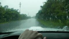 Driving a car with broken windscreen wiper Stock Footage