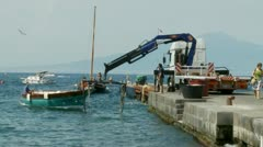 Preparing to take boat out of sea (PART 2), Sorrento Stock Footage