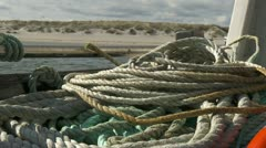 Focus pull from rope/boat too beach (pro res) Stock Footage