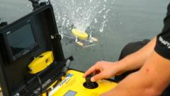 Man operating a ROV unit Stock Footage
