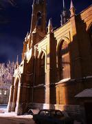 Roman catholic kostel in a full moon night - stock photo
