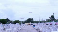 Airplane over cemetery Stock Footage