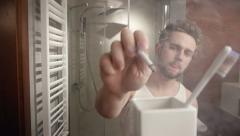 Man's bathroom routine Stock Footage