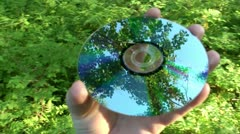 Laser disk with reflection from the surface of a wood thicket Stock Footage