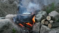 Teapot on campfires Stock Footage