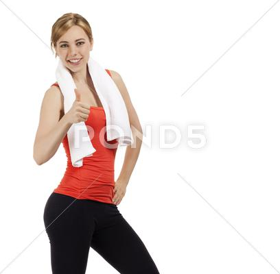 Stock photo of happy fitness woman showing thumb up
