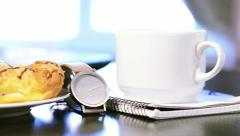 laptop and cup of hot coffee on table - stock footage