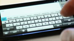 typing on touch screen phone - stock footage