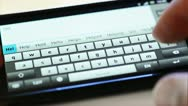 Typing on touch screen phone Stock Footage