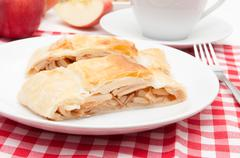homemade apple strudel and coffee on the table - stock photo