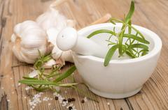mortar with rosemary - stock photo