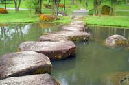 Stoneway and small lake in the Chinese garden Stock Photos