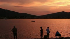 Group of people fishing ( silhouette ) Stock Footage