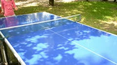 Playing table tennis in the park Stock Footage