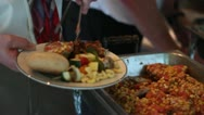 Stock Video Footage of CU Man Loading Plate from Buffet Chiken