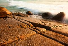 Sea tide in sunset lights Stock Photos