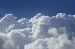 high altitude cumulus clouds - stock photo