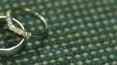 Stock Video Footage of ECU Pan Across Wedding Bands Rings