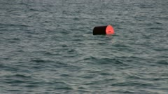 buoy bobs on the waves - stock footage
