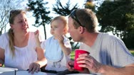 Parents Feeding Pizza Slice to Toddler Baby Boy Stock Footage
