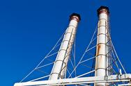 Stock Photo of white chimneys and blue sky