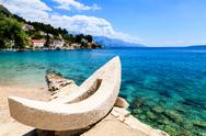 Stock Photo of white boat and azure adriatic bay in croatia