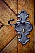 retro keyhole in old wooden door - stock photo