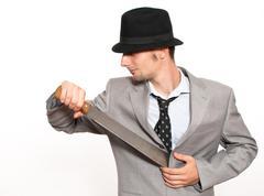 Young businessman holding a machete Stock Photos