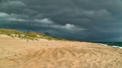 Severe storm clouds moving in on beach Stock Footage