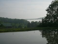 Still Lake Valleys And Fog - stock photo