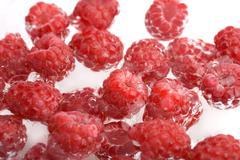 Fresh raspberries in water Stock Photos