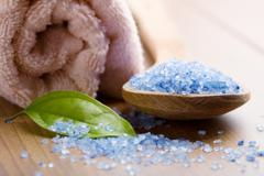 herbal salt and towel. spa and body care background - stock photo