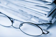 Newspapers and glasses toned blue Stock Photos