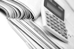 Newspapers, pen and calculator. business background Stock Photos