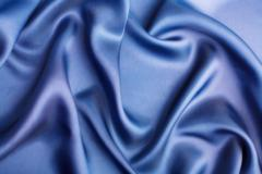 Abstract blue silk background Stock Photos
