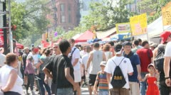 Hot summer outdoor crowd people street busy Stock Footage