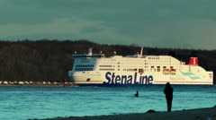 Stena Line and fisherman at sunset, panning Stock Footage