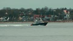 Coast Guard cruising near Laboe beach, Germany, slow motion Stock Footage