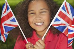 beautiful mixed race girl with union jack flags - stock photo