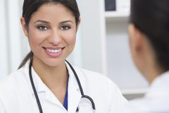 hispanic female woman hospital doctor in meeting - stock photo