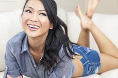beautiful sexy chinese oriental asian woman smiling in shorts - stock photo