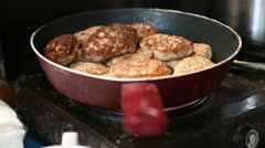 Pan with cutlets on electric kitchen range Stock Footage