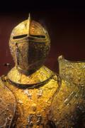 elaborately decorated tournament armor of medieval knight - stock photo