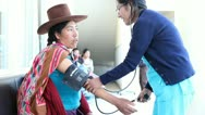 Stock Video Footage of Nurse taking the blood pressure of pregnant Peruvian woman.