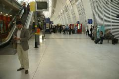passengers await the arrival of the high speed train .. - stock photo