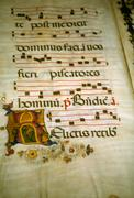 Illuminated manuscript, in medieval library Stock Photos