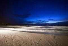 Tropical night at the beach. Stock Photos