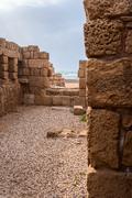 ruins of the ancient romanian harbor, caesarea - stock photo