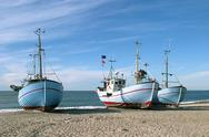 Stock Photo of Coastal fishing boat on shore. Nr. Vorupoer, Denmark.