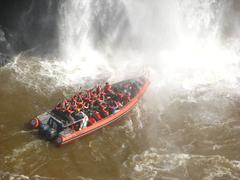 Tourist adventure boat in iguacu falls - stock photo